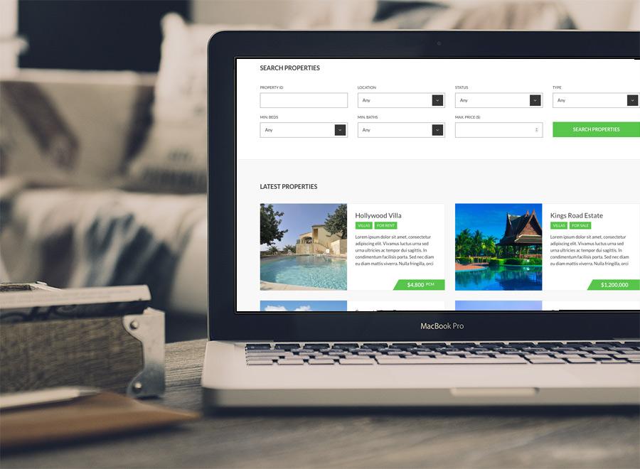 Screenshot of Real Estate WordPress theme Oikia on Laptop